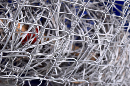 security gap: barbed wire fence in wire mesh fence