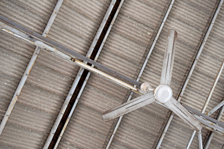 fluorescent lamp: Ceiling Fan Fluorescent Lamp and roof Tiles Stock Photo