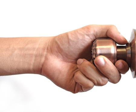 Mans hand hold doorknob on isolate white background Stock Photo