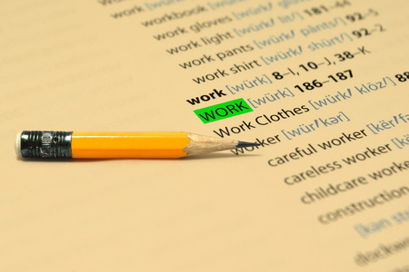 work book: WORK - The words highlight in the book and pencil