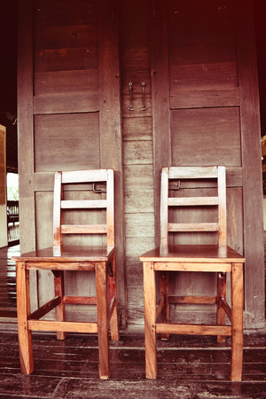 path cottage garden: Double wooden chairs on wood house thai retro style Stock Photo