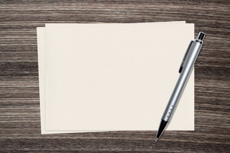 sliver: Sliver Pen and paper on wood background Stock Photo