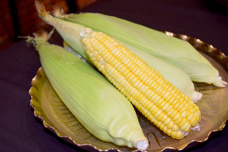 yellow corn: Green and yellow Young corn on Gold tray Stock Photo