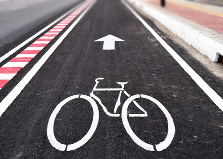 healthy path: White arrow and bycicle sign on lanes road