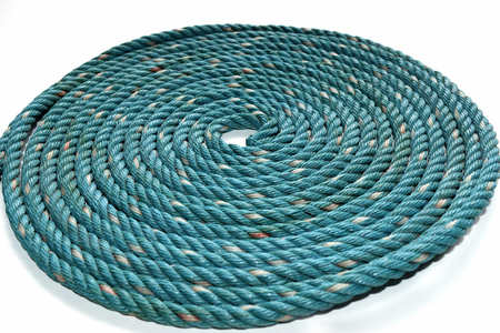 woven: Circle Roll texture of old green nylon rope. Stock Photo
