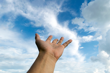 hope concept: Hands raise requests up in the sky Stock Photo