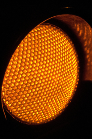 trafic stop: Close up Yellow Traffic lights at night
