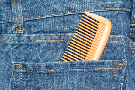 comb: Comb in jean pocket background
