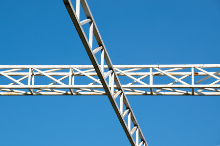 steelwork: White steel cross structure on blue sky Stock Photo
