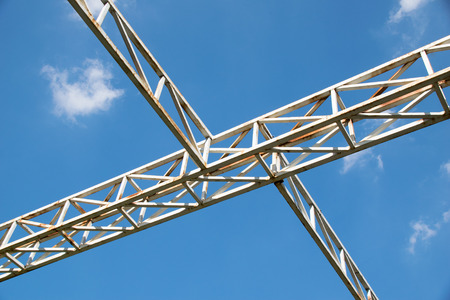 steel structure: White steel cross structure on blue sky Stock Photo