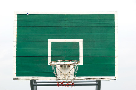 layup: Basketball Hoop  - Outdoor basketball hoop and green backboard, taken from a front view. Isolated on sky background.