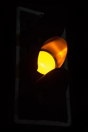 red fish: Close up Yellow Traffic lights at night