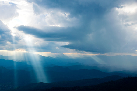 bright light: The sun shining down from heaven on the mountain. Stock Photo