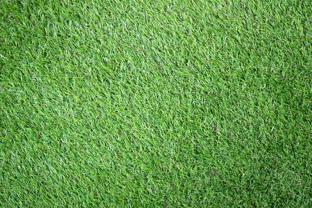 クローズ アップ緑人工草のテクスチャ背景
