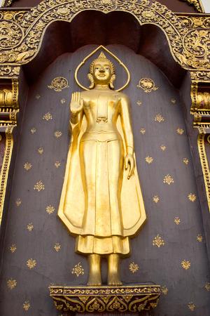 buddha hand: Gold Buddha - Standing Buddha and The attitude of stopping the rainstorm