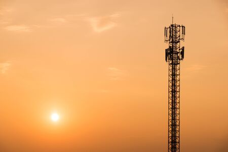 cell tower: Cell Phone Antenna Tower on orange sky and sun