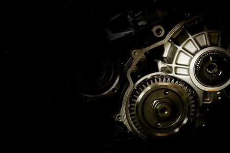 Gear motor cars on black background