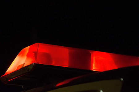 red light: Red Police siren beacon light flashing on car