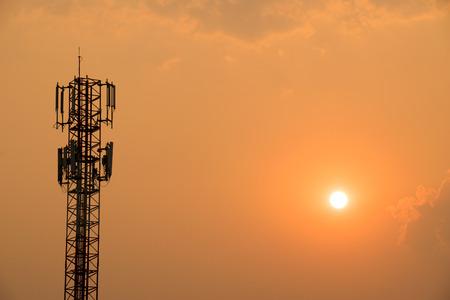 antenna: Cell Phone Antenna Tower under orange sky and sun