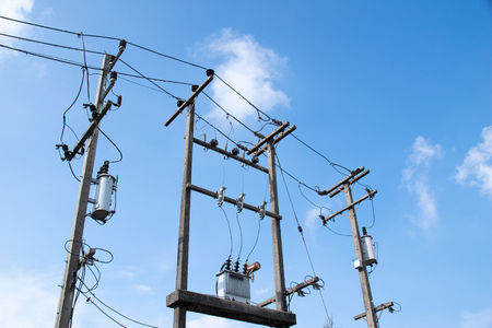 voltage gray: High Voltage Transformers and Electricity wire on the pole. Stock Photo