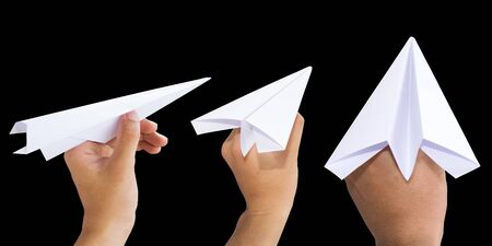hand paper: Holding White Paper rocket isolate on black background