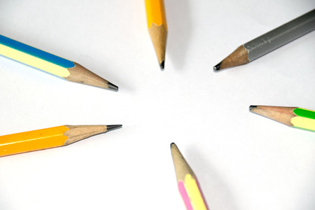order chaos: Pencils put on white floor to circle