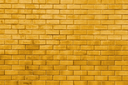 Yellow gold brick wall abstract texture background Фото со стока