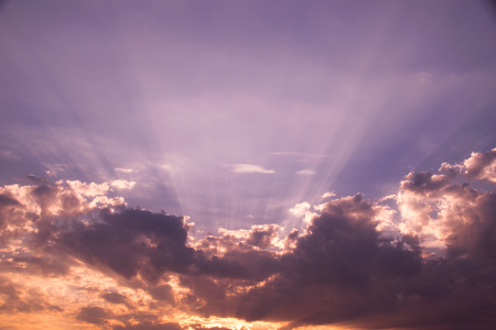 heaven light: Sun shines and cloud  on purple sky