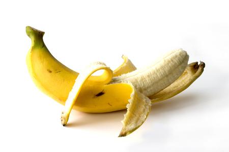 banana skin: Yellow banana curve peeled isolate on white background Stock Photo