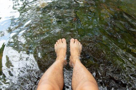 Top view of Feet soaking in the stream