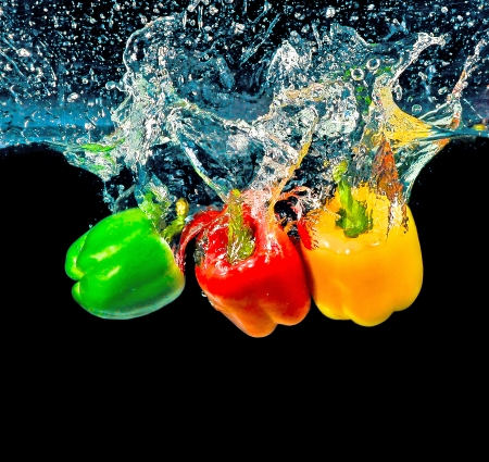 Three of a kind peppers into water photo