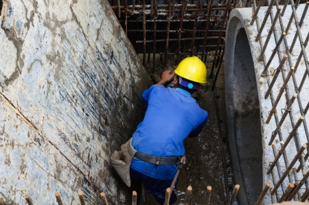 tunneling: worker, man draining water  Stock Photo
