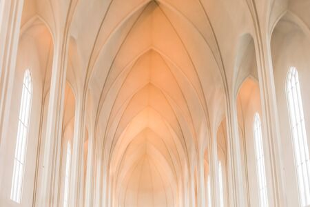 louvered: Hallgrimskirkja Church, Reykjavik, Iceland. Interior with concrete in perspective construction decorative ceiling with curve. Stock Photo