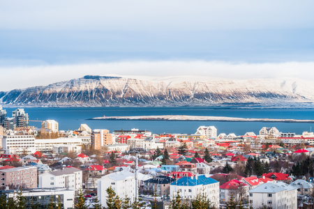 Beautiful view of  Reykjavik winter in Iceland winter season with snow-capped mountain in the background, Reykjav�?���?¯�?¿�?½�?���?��?­k is the capital city of Iceland.with snow-capped mountain in the background, Reykjav�?���?�