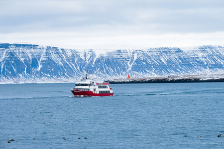 Travel Beautiful view of the Iceland winter season by ferry or cruise ship. Snow-capped mountain in the background