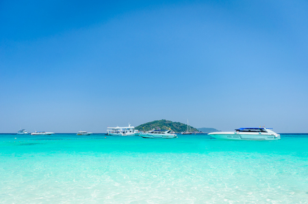 Beautiful tropical beach, white sand and blue sky background with travel yacht boat. Seascape or Landscape at similan island, andaman sea, pacific ocean