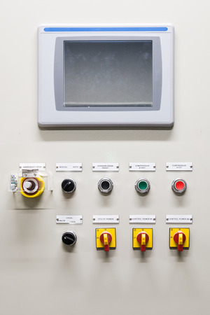 Electrical control panel contains switch buttons for operating industrial machine and factory equipment in industry, Lab, laboratory. Usually press green button to start, red button to stop and some p