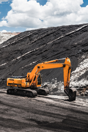 Track-type loader, excavator machinery in open pit or open-cast coal mine the mining industry that large, or huge machine used in bulk material handling in stockpile as the Coal Production.