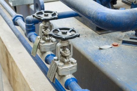 Close-up Industrial Valve contain the gas, oil or water on the pipeline. Processing Plant operates and control by opening, closing and isolate valve with the steel pipe and equipment. 写真素材