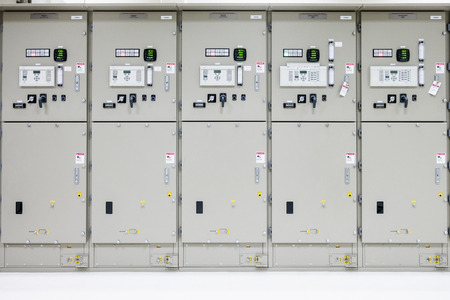 Electrical Room, medium and high voltage switcher, equipment, panel to control and protect the electrical equipment and system by fuse, circuit breaker, control panel at power factory, power plant and substation. Archivio Fotografico