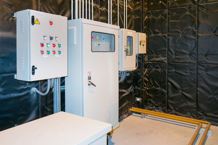 Electrical Room, medium and high voltage switcher, equipment, panel to control and protect the electrical equipment and system by fuse, circuit breaker, control panel at power factory, power plant and substation. Stock Photo