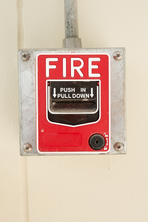 Fire Alarm or Fire Manual Call Point equipment in red box on the cement wall for warning, alert and sign to evacuation alarm building by exit passage way before Rescue Team attack the fire fighting. 写真素材