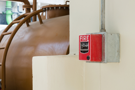 Fire Alarm or Fire Manual Call Point equipment in red box on the cement wall for warning, alert and sign to evacuation alarm building by exit passage way before Rescue Team attack the fire fighting. Archivio Fotografico
