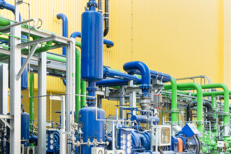 Colorful industrial piping or pipelines. Industrial process piping, valves, fitting, flanges at refinery manufacturing, oil plant or power plant transfer gas, water in the blue sky background. 写真素材