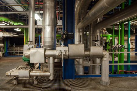 Industrial Steel or Stainless Piping, tubes and Equipment as found inside of modern thermal and combine cycle power plant for electricity generation or Refinery chemical plant or manufacturing plant. Archivio Fotografico