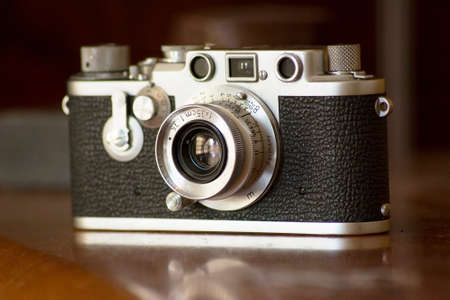 Vintage 35mm film camera seen from front angle