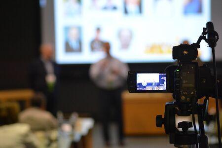 Speaker in Auditorium Recorded on Video Camera
