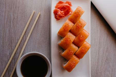 Philadelphia roll sushi with cucumber, cream cheese, red caviar. Sushi menu. Imagens