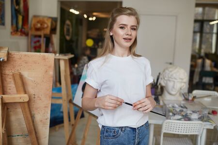 A young artist creates her first sketches with a brush