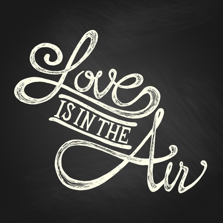 date stamp:  Love is in the air - Hand drawn quotes, white on blackboard